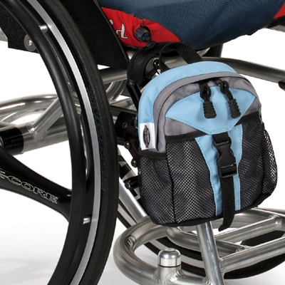 Wheelchair Mini Backpack model The Pack Rat Jr Mini Pack attached to a wheelchair