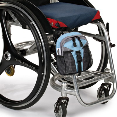 Wheelchair Mini Backpack model The Pack Rat Jr Mini Pack attached to the front of a wheelchair