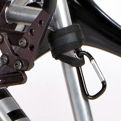 Wheelchair grip clip attached to wheelchair frame close up view