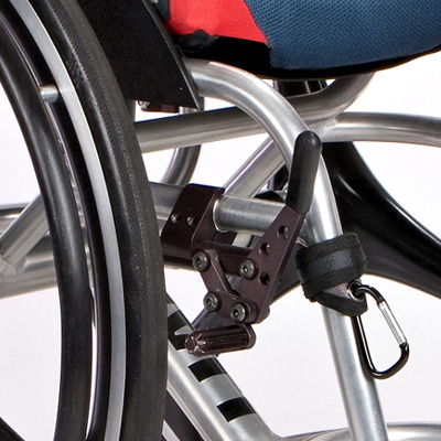 Wheelchair grip clip attached to wheelchair frame front view