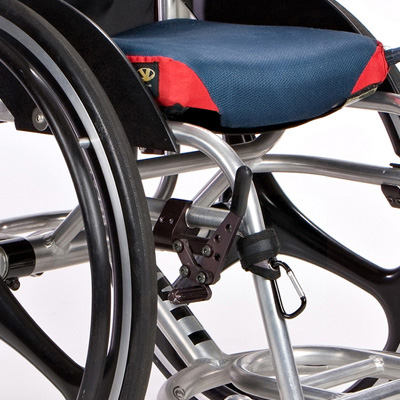 Wheelchair grip clip attached to wheelchair frame