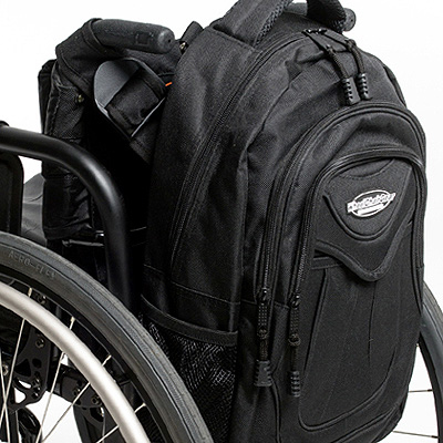 side view of Slice Wheelchair Backpack attached to the back of a wheelchair