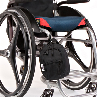 wheelchair bag model The Slice Jr Mini Pack Black attached the a wheelchair
