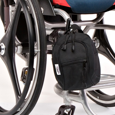 wheelchair bag model The Slice Jr Mini Pack Black front of a wheelchair
